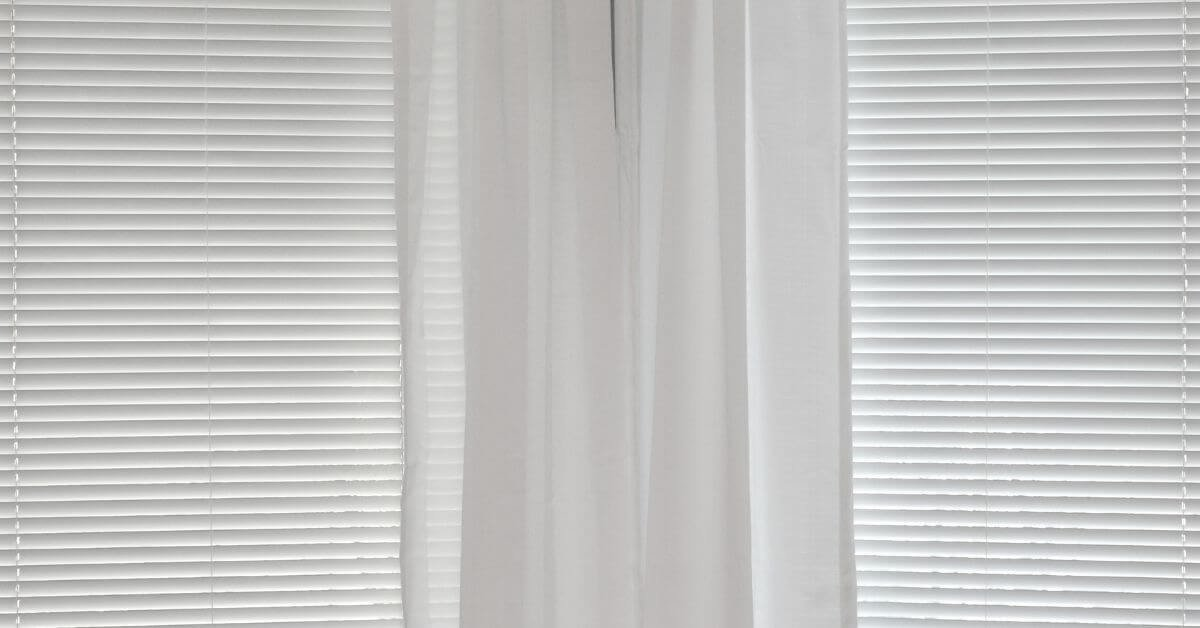 pairing blinds and curtains together